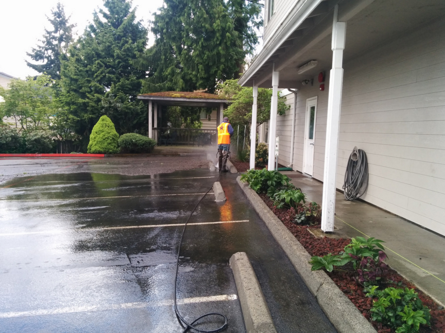 power washing a parking lot for a Little Rock business owner