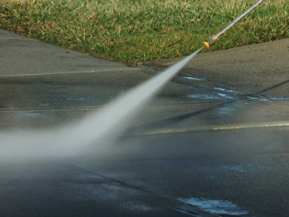 pressure washing service cleaning a sidewalk in Little Rock